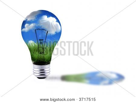 Green Grass And Blue Sky In A Lightbulb Energy Concept