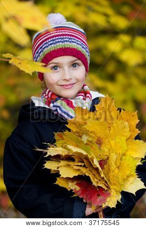 Autumn portrait - lovely girl in autumn park