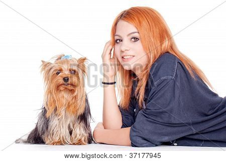 young woman with cute little yorkshire terrier