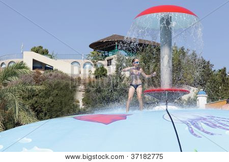 Girl Playing On Wet Bubble Game Pool