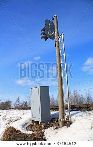 railway semaphore on blue background