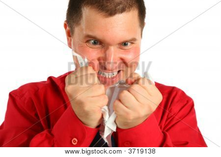 Irate Man In Red Shirt Rips Sheet Of Paper