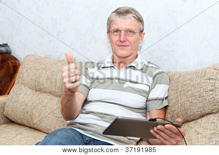 It Is A Good Thing A Tablet Pc For Active Senior Man  Senior Adult Caucasian Man Interested With A N