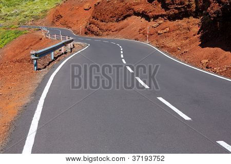 Canary Islands winding road curves in red mountain
