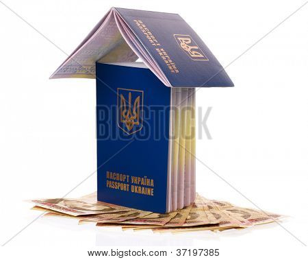 Two international Ukrainian passport with Hryvna banknotes isolated on background