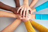 foto of japan girl  - High view of team of friends showing unity with their hands together - JPG