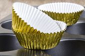 Golden Cup Cake Cases On A Baking Tin