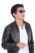 foto of swagger  - young man wearing leather jacket and sunglasses - JPG