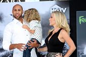 LOS ANGELES - SEP 24:  Hank Baskett, Hank Baskett Jr., Kendra Wilkinson arrives at the