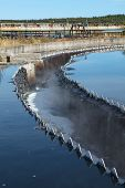 image of sedimentation  - Drainage in sedimentation reservoir with clean water overflowing - JPG