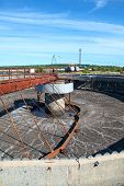 picture of sedimentation  - Empty huge round form sedimentation settler tank in treatment plant - JPG
