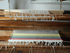 stock photo of handloom  - Handloom in front view - All strings attached - Textile abstract ** Note: Slight graininess, best at smaller sizes - JPG