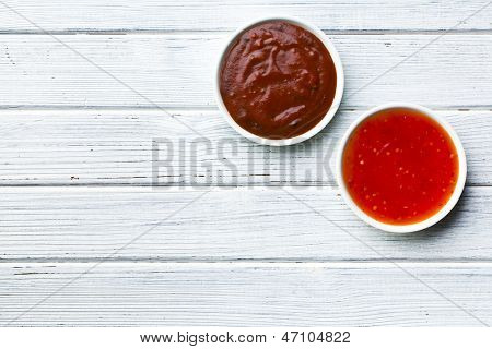 the various barbecue sauces in ceramic bowls