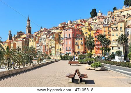 View of promenade and old medieval town with multicolored houses of Menton on french riviera in France.