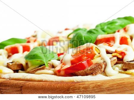 Vegetarian pizza with peppers, mushrooms, tomatoes, olives and basil