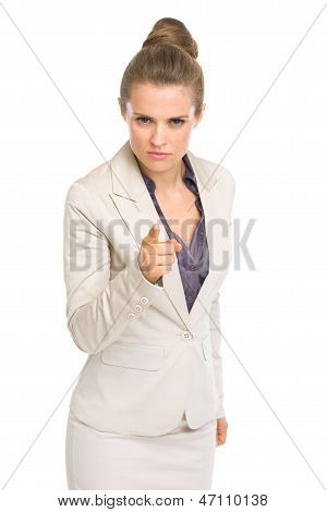 Serious Business Woman Pointing In Camera