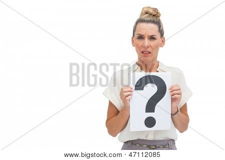 Uncertain businesswoman with question mark looking upwards