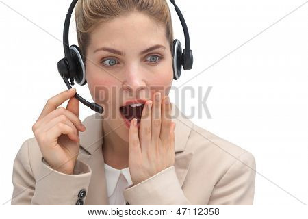 Astonished call center agent with headset