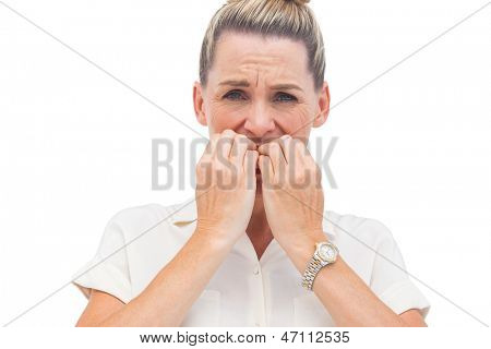 Businesswoman biting nails with anxiety
