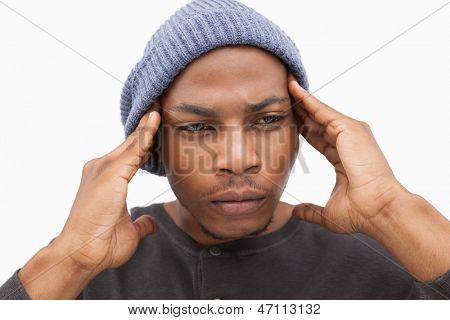 Worried man in beanie hat on white background