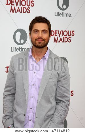 "LOS ANGELES - JUN 17:  Eric Winter arrives at the ""Devious Maids""  Lifetime's Original Series Premiere at the Bel-Air Bay Club on June 17, 2013 in Pacific Palisades, CA"