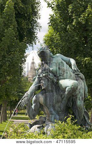 Fountain Sculpture Vienna Austria  Park With Museum In Background Museum Quartier