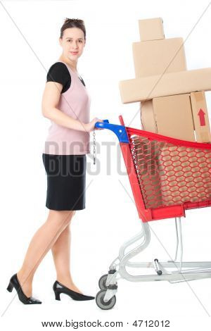 A Woman Pushing A Cart Full Of Goods