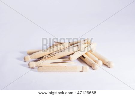 Wooden Dolly Pegs On White Background
