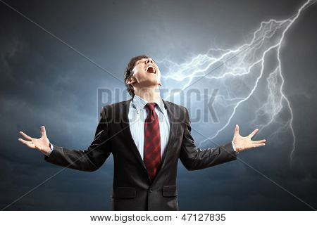 businessman in anger with fists clenched screaming