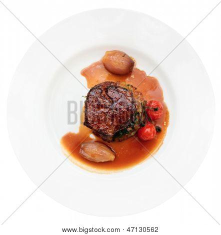 Tenderloin steak in plate, isolated on white background