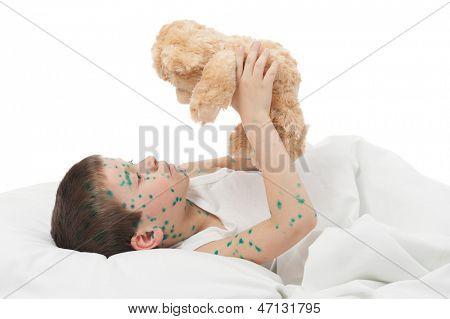sick boy in a white bed