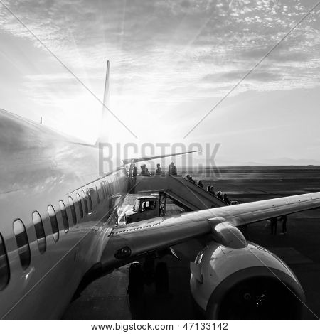 aircraft in airport at sunset