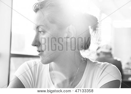 elegant woman in cafe is looking sideways