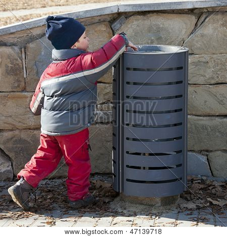 Child At Rubbish Bin
