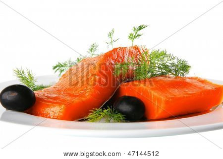 pink salmon bit on a big white dish