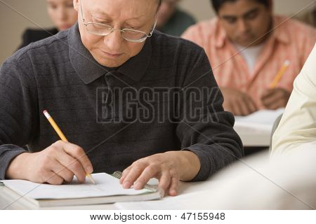 Man writing in classroom