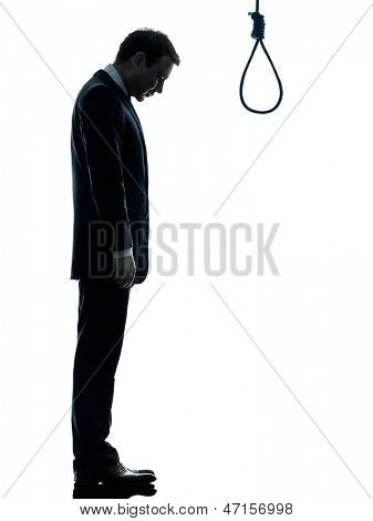 one caucasian man standing in front of hangman's noose in silhouette studio isolated on white background