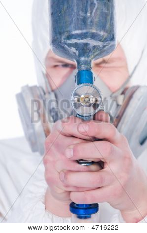 Close-up Of Worker With Airbrush Gun