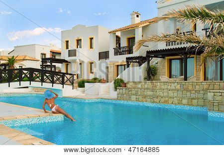 Sexy Woman Look On Small Bridge And Traditional Greek Bungalo Near Pool On Sunset