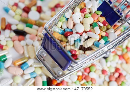 Many colorful medication in a shopping cart