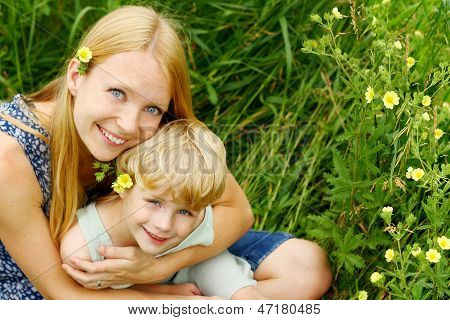 Mother And Child Hugging Outside