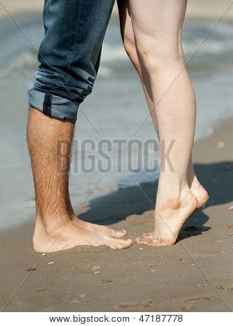 Legs Of Couple On The Beach