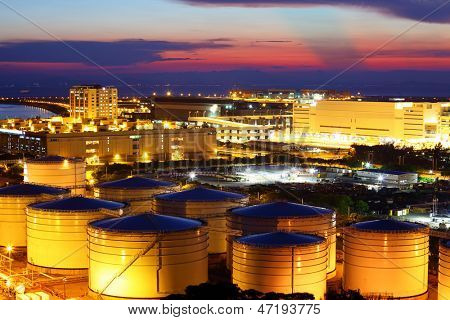 Oil tank in cargo service terminal at night