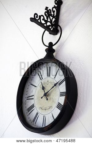 Old clock hanging on wall
