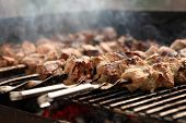 pic of brazier  - Fresh meat on a steel skewer in a smoke at brazier - JPG