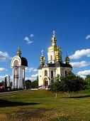 stock photo of deacon  - beautiful church with golden domes on a background of the blue sky - JPG