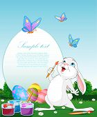 image of easter bunnies  - Illustration of an Easter Bunny painting Easter Eggs - JPG