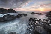 picture of unique landscape  - Sundown over Giants Causeway landscape North Ireland - JPG