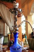 stock photo of shisha  - Shisha is on a table in an asian restaurant - JPG