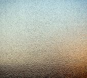 stock photo of stippling  - Abstract of stippled glass window pane with ambient colours from outside as background texture - JPG